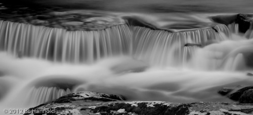 A very long exposure to blur the spray flying at the bottom of this minature falls.